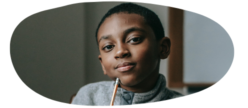 Boy with pencil looking pensive