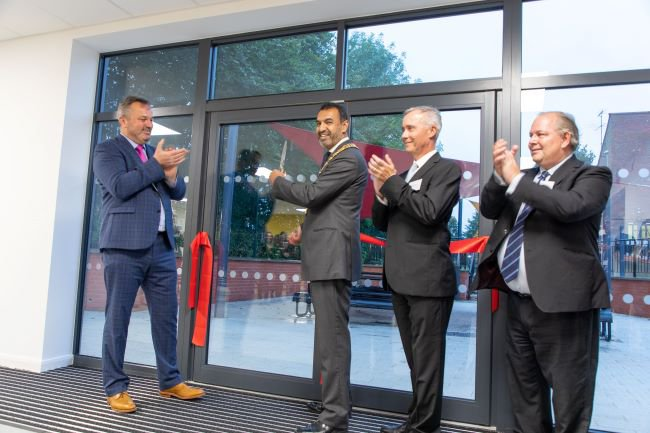 Andrew McGinnes (Headteacher), Councillor Zahir Mohammed (Chairman of the Council),  Matthew Watkins (Chair of Governors), and Councillor John Chilver (Cabinet Member for Finance, Resources, Property and Assets) cut the ribbon at the opening ceremony