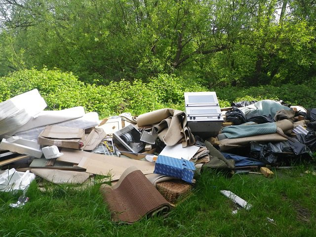 A pile of rubbish on the grass