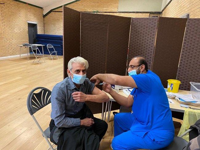 man receiving COVID-19 vaccination