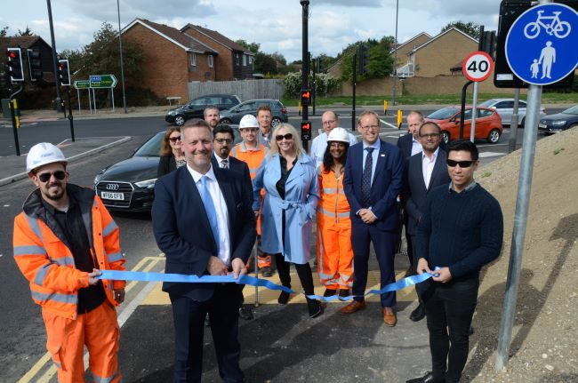Images showing Buckinghamshire Council Cabinet Member for Transport, Steven Broadbent, cutting a ribbon to declare the new Crest Road junction open for business.
