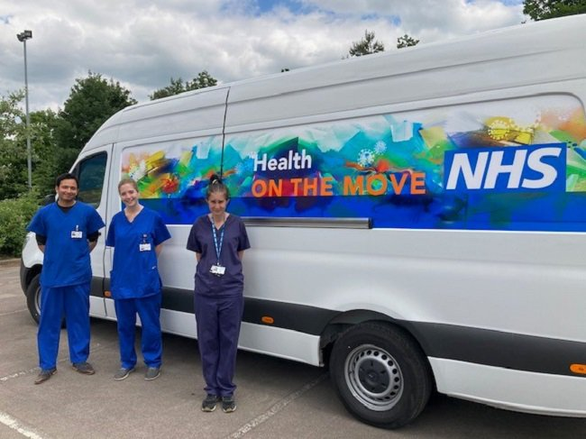 NHS vaccinators along with the Health on the Move van.