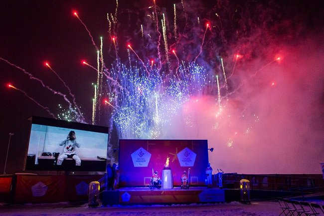 Fireworks, crowds and digital screens at the Paralympic Heritage Flame Lighting Ceremony at Stoke Mandeville Stadium, which marked the official Paralympic Torch Relay for the PyeongChang 2018 Winter Paralympic Games.
