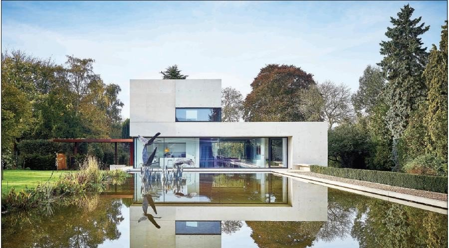Pheasants: a very modern L-shaped house complete with a pond in Hambleden