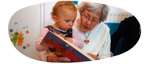 Grandma reading to grandchild