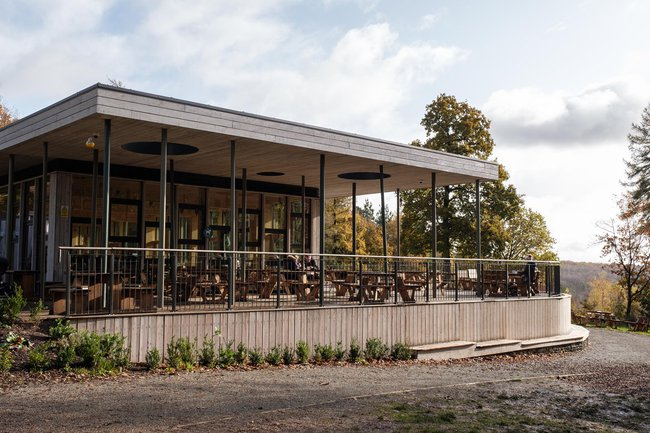 Wendover Woods Cafe: primarily glass building with wooden details and a flat-top roof
