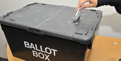 elections hand with ballot paper and ballot box (1).jpg